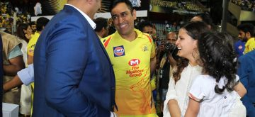 Mumbai: Chennai Super Kings skipper MS Dhoni with BCCI Treasurer Anirudh Chaudhry after winning IPL 2018 trophy at Wankhede Stadium in Mumbai on May 27, 2018. Also seen Dhhoni's wife Sakshi and their daughter Ziva. (Photo: Surjeet Yadav/IANS)