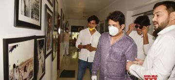 Patna: RJD leader Tejashwi Yadav shows through the photo library to actor Shekhar Suman during his visit to the party office in Patna on June 30, 2020. (Photo: IANS)