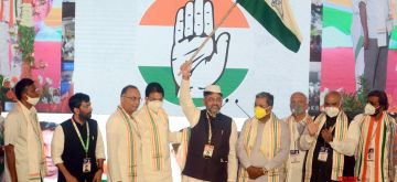 Bengaluru: Congress troubleshooter D.K. Shivakumar, 58, took reins of the party's Karnataka unit as president in style, with hundreds of party leaders and cadres witnessing the spectacle across the state through live streaming under the shadow of Covid cloud, in Bengaluru on July 2, 2020. Shivakumar took oath as the Karnataka Pradesh Congress Committee (KPCC) president on 'Pratigna Dina' (Day of Oath) in Kannada at the party office in compliance with the lockdown guidelines, which restricted the gathering to about 50 people. Party's General Secretary K.C. Venugopal, party's newly-elected Rajya Sabha member from the state Mallikarjun Kharge, Congress Legislature Party leader Siddaramaiah, former state chief Dinesh Gundu Rao, former Union Minister Rehman Khan and party's women's wing head Pushpa Amarnath were present on the occasion. (Photo: IANS)