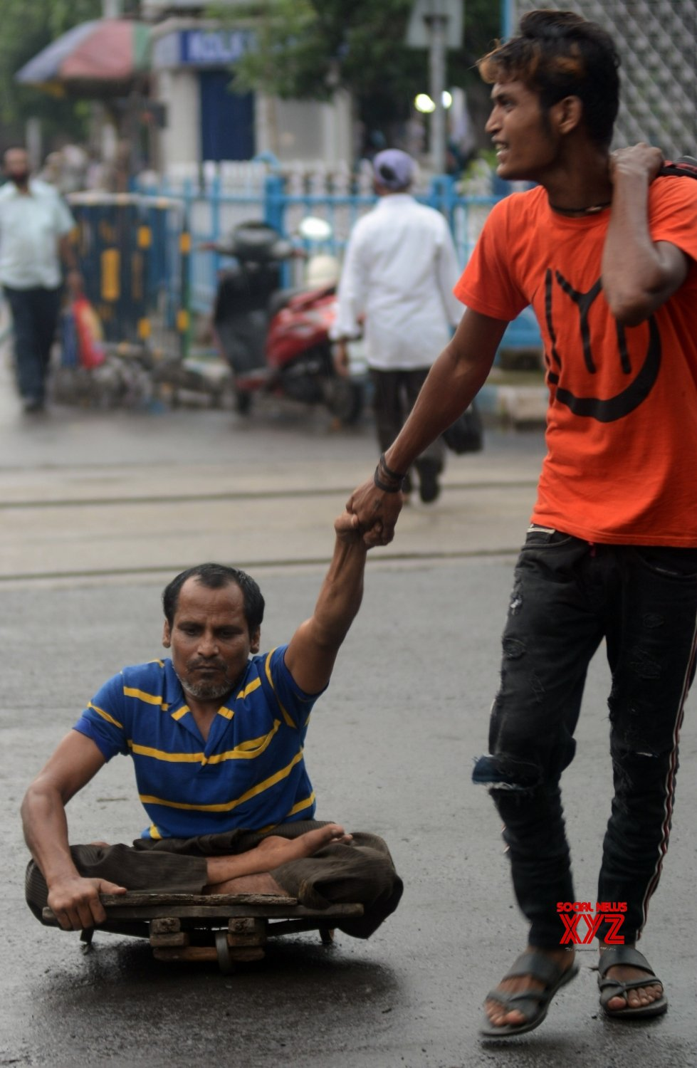 Kolkata: Specially - abled person being assisted by a family member #Gallery