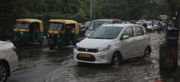 New Delhi: Commuters wade through the water-logged Sri Aurobindo Marg after rains in New Delhi on Aug 1, 2020. (Photo: IANS)