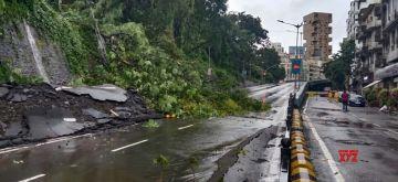 Mumbai: Landslide occurs at Peddar road following incessant rains in Mumbai on Aug 6, 2020. (Photo: IANS)