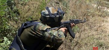 Baramulla: An army personnel takes position during an encounter between the security forces and terrorists in North Kashmir's Baramulla district on Aug 22, 2020. One terrorist was killed in the encounter. The encounter erupted after a joint team of the police and the army cordoned off the Saloosa area following information about the presence of terrorists. As the security forces zeroed in on the spot, they came under a heavy volume of fire that triggered the encounter. Two to three terrorists were believed to be trapped. (Photo: IANS)