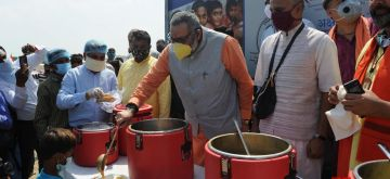 New Delhi: Union Minister Giriraj Singh serves food to the Hindu migrants from Pakistan at a Majlis Park camp on the occasion of Prime Minister Narendra Modi's 70th birthday, in New Delhi on Sep 17, 2020. (Photo: IANS)