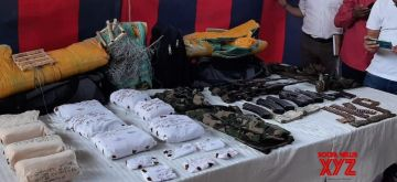 Rajouri: Three suspected Lashkar-e-Taiba terrorists were arrested by the security forces from Rajouri district of Jammu and Kashmir with a large cache of arms and ammunition they had received through drones, on Sep 19, 2020. All three belong to South Kashmir's Pulwama district and have been identified as Rahil Bashir, Amir Jan and Hafiz Younis Wani. The weapons recovered include two AK-56 rifles, 6 AK-Magazines with 180 rounds, two Chinese pistols, three pistol magazines with 30 rounds, four grenades and Rs 1 lakh in cash. (Photo: IANS)