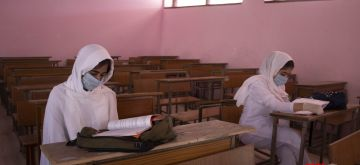 Srinagar: Schools in Jammu and Kashmir reopened for Classes 9 to 12, in Srinagar on Sep 21, 2020. In a bizarre move, the Directorate of School Education has devised an undertaking to be furnished by the parents, which puts the entire responsibility for the safety of children on the parents. The undertaking also says that the parents will provide face masks, sanitizers and also ensure that the children do not wear any belts, rings, wrist watches, etc., those could become causes for the spread of the coronavirus infection. Educational institutions were closed in Kashmir on August 5, 2019 after Article 370 was abrogated and the state downgraded into two union territories of J&K and Ladakh. (Photo: IANS)