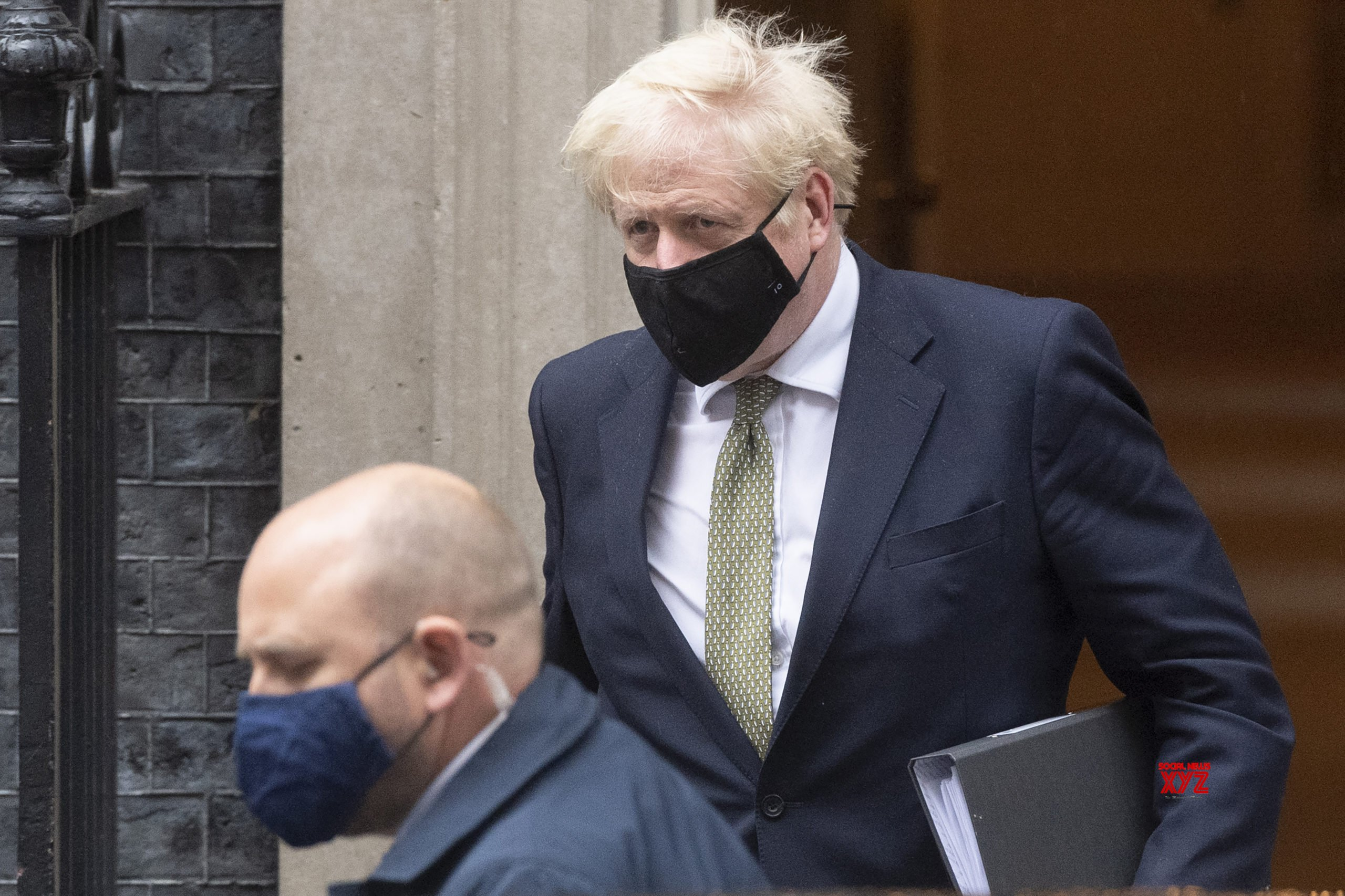 Johnson defends Covid-19 curbs as 'right, responsible thing'