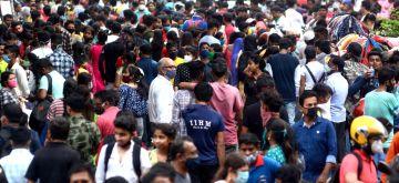 Kolkata: People shopping at New market area on eve of Durga Puja festival in Kolkata on October 18, 2020. (Photo: IANS)