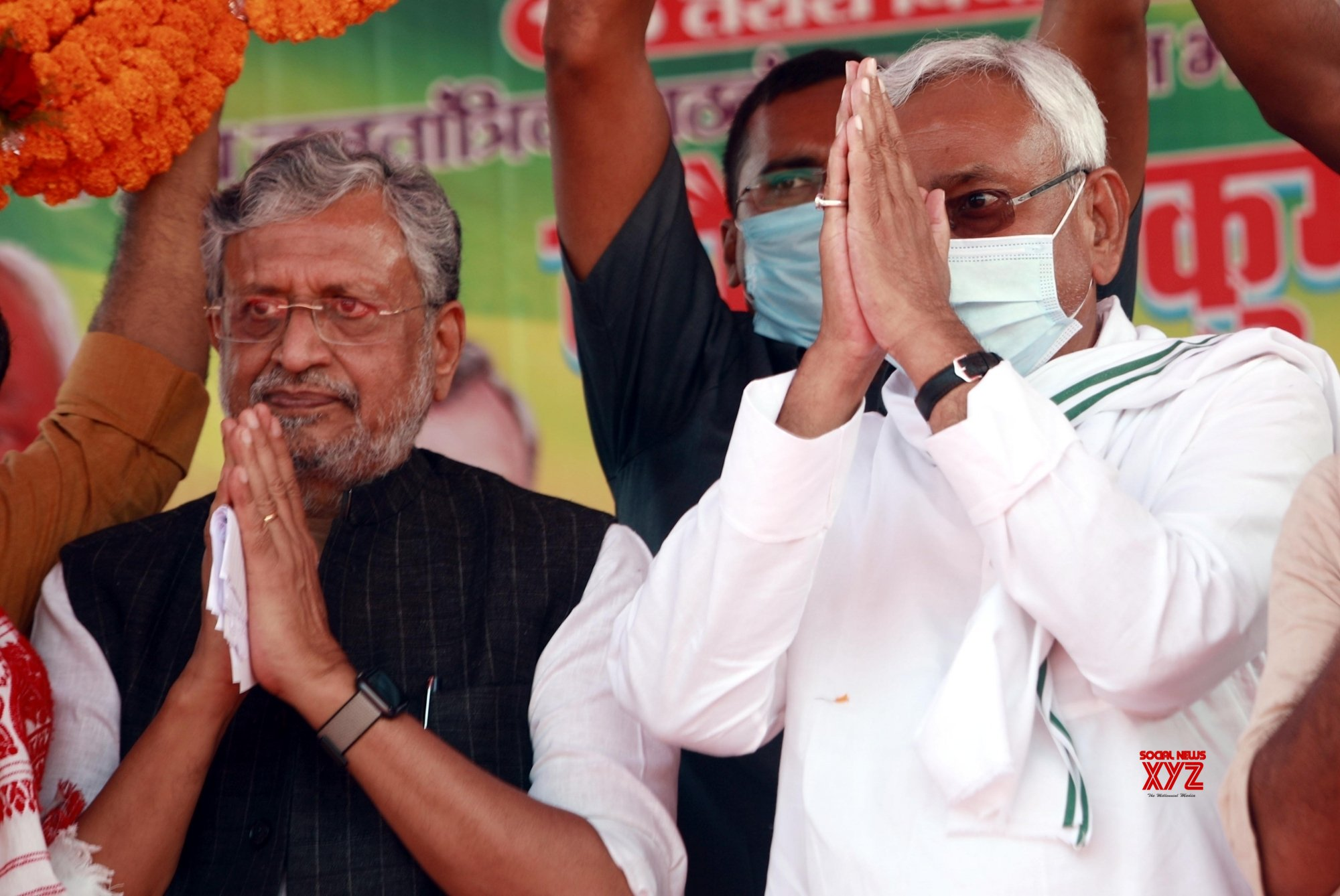 Bhojpur: Nitish Kumar with Susheel Kumar Modi being garland by supporters during an election meeting #Gallery