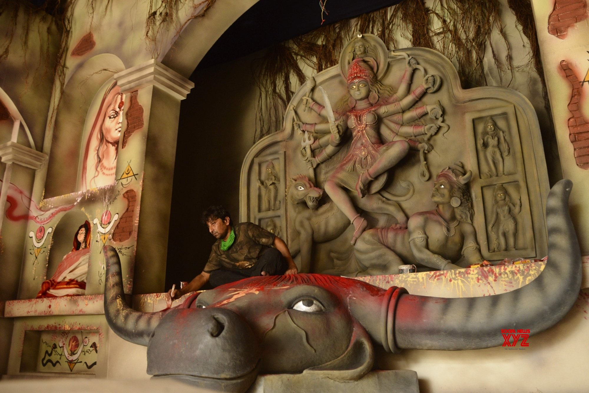 Kolkata: Artist gives finishing touches to an idol of Goddess Durga at the community Puja pandal ahead of Durga Puja festival #Gallery