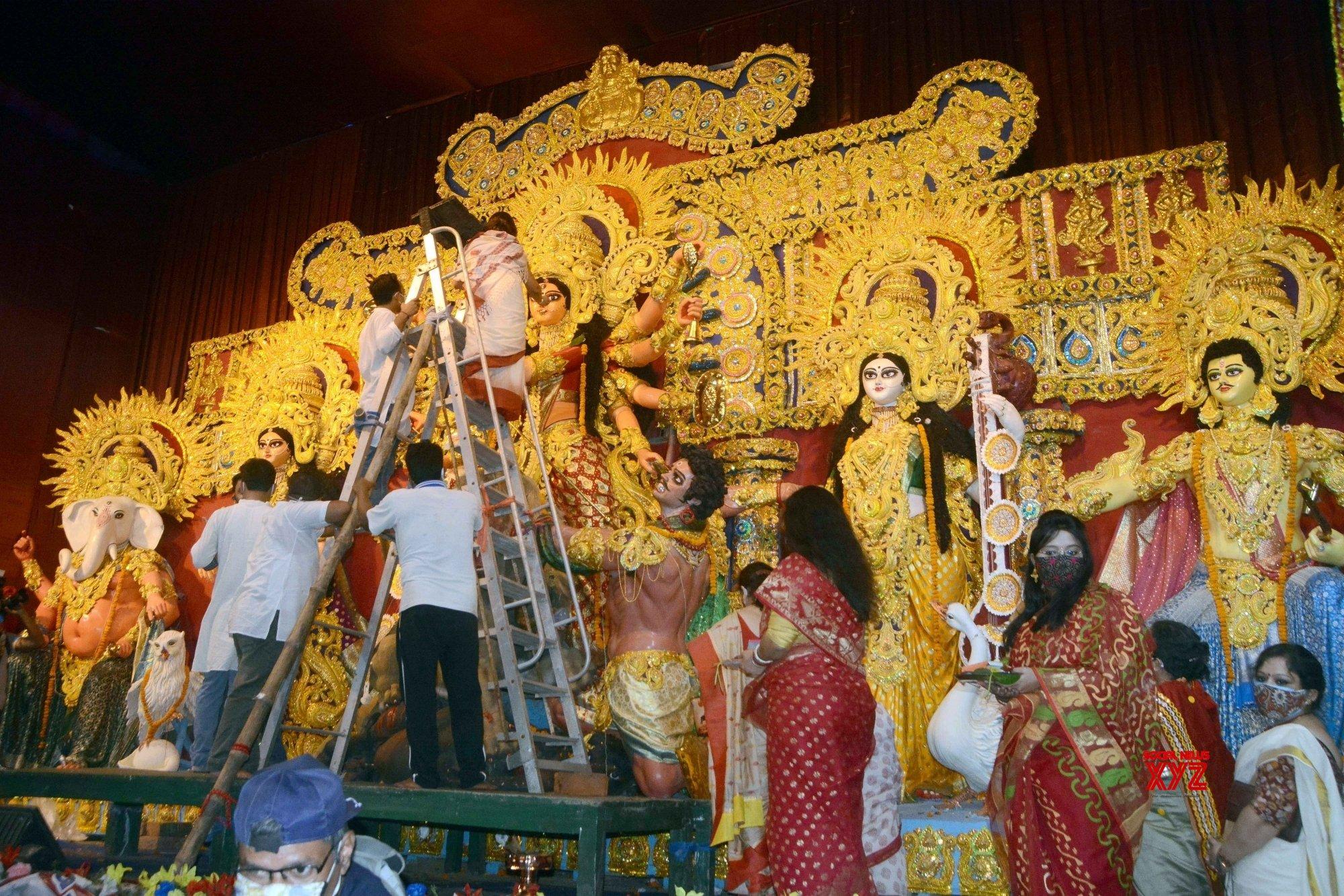 Kolkata: Women perform rituals ahead of Durga idol immersion at Ekdalia Evergreen Club community puja pandal #Gallery