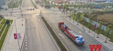 Chongqing, Nov. 18 (Xinhua) --  Aerial photo taken on Nov. 17, 2020 shows a cross-border highway regular lorry for Kazakhstan leaving the Nanpeng Highway Bonded Logistics Center in southwest China's Chongqing Municipality. (Xinhua/Huang Wei/IANS)