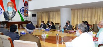 Chandigarh: Haryana Chief Minister Manohar Lal Khattar and State Health Minister Anil Vij attend the high-level meeting chaired by Prime Minister Narendra Modi to take stock of the Covid-19 situation in the eight worst-hit states in his first leg of PM-CM meeting via video conferencing, in Chandigarh on Nov 24, 2020. (Photo: IANS)