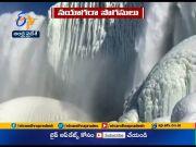 Niagara Falls Encrusted | in Ice as Rainbow Appears  (Video)