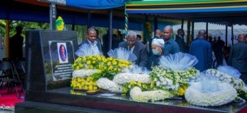 People present wreaths at the tomb of former Tanzanian President Magufuli in Chato, Tanzania, on March 26, 2021.(Tanzania Information Services/Handout via Xinhua/IANS)