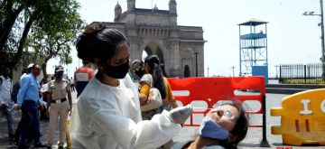 Mumbai: Citizens of Denmark country getting  their Antigen Rapid test for Covid-19 on their visit to Gateway of India in Mumbai on Friday 02nd Aril, 2021. (Credit: Sandeep Mahankal/IANS)