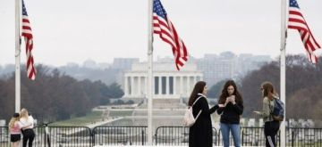 Washington: People gather near the Washington Monument in Washington, D.C., the United States, on March 25, 2021. (Photo by Ting Shen/Xinhua/IANS)