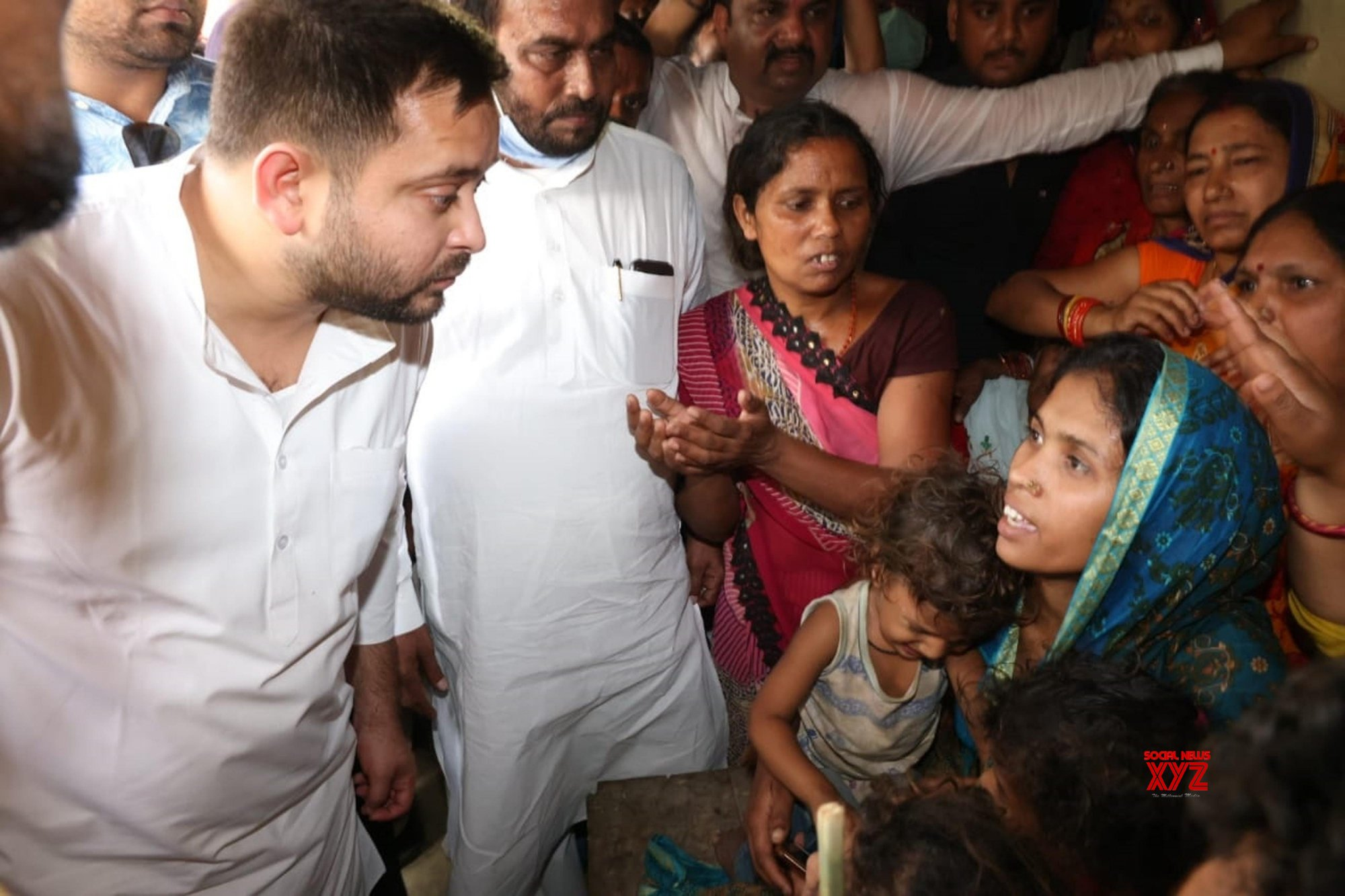 Patna: Madhubani : Rashtriya Janta Dal leader Tejaswi Yadav meet with Victims families of Muhammadpur murder case, in Madhubani district on Tuesday April 6,2021. #Gallery
