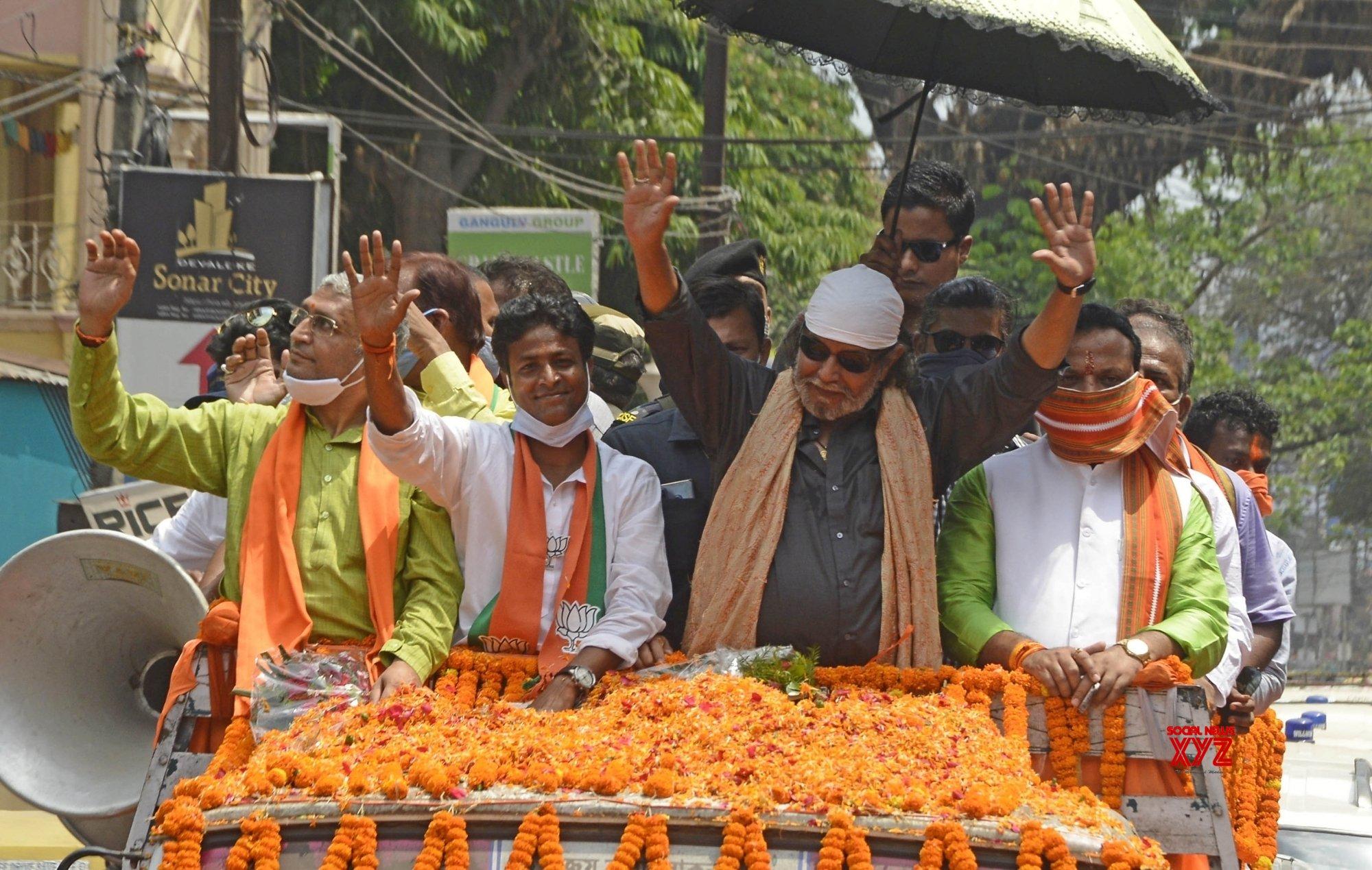 Kolkata: Actor turned BJP leader Mithun Chakraborty at a roadshow at Gariya ahead of the 4th phase of the State Assembly election in Kolkata. #Gallery