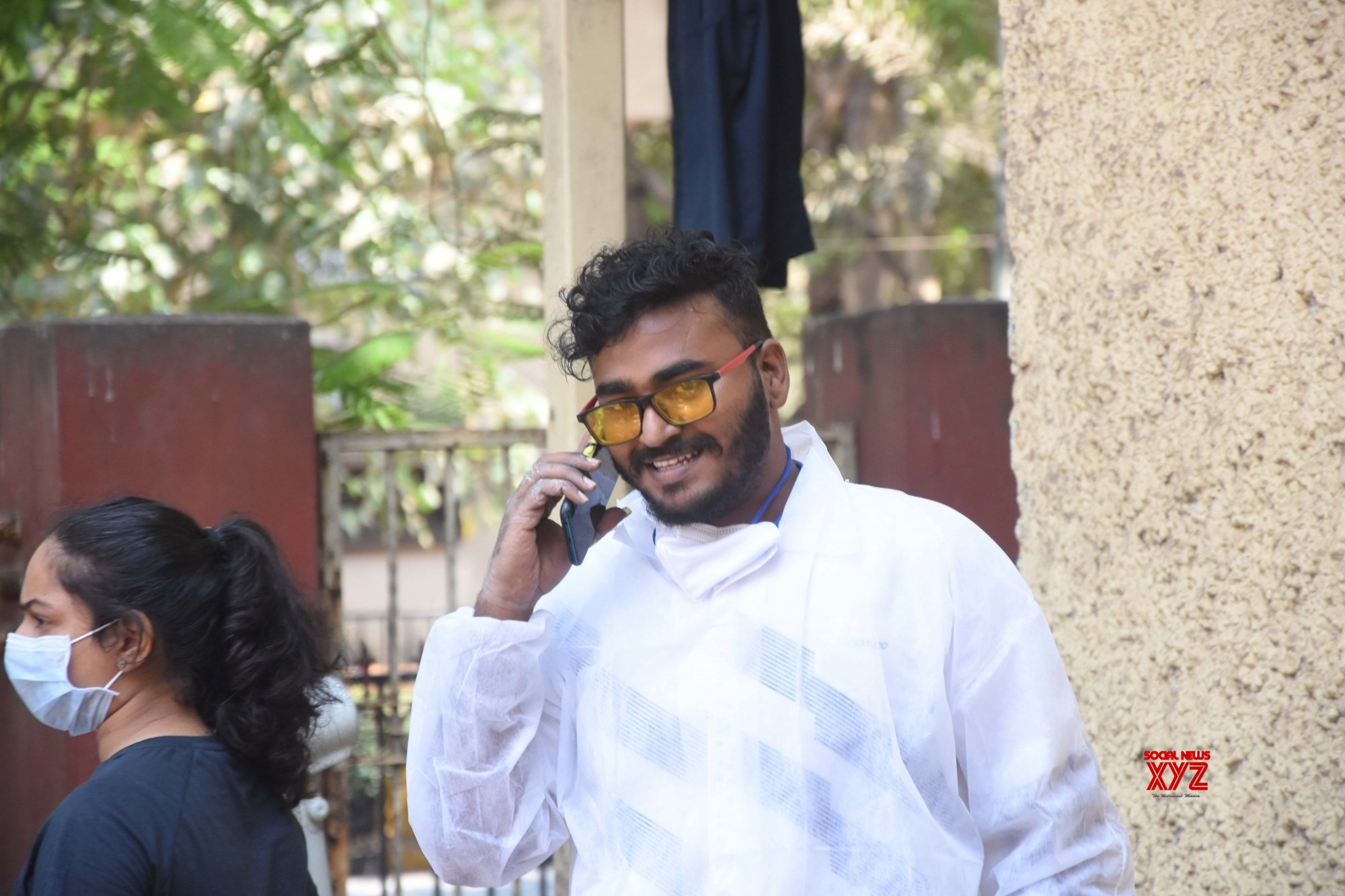 "Mumbai: State Government all over Maharashtra people have told ""Mask wear compulsory and protect your life"" but see this health worker no care without mask enjoying call at Dadar in Mumbai on Wednesday April 07, 2021. #Gallery"