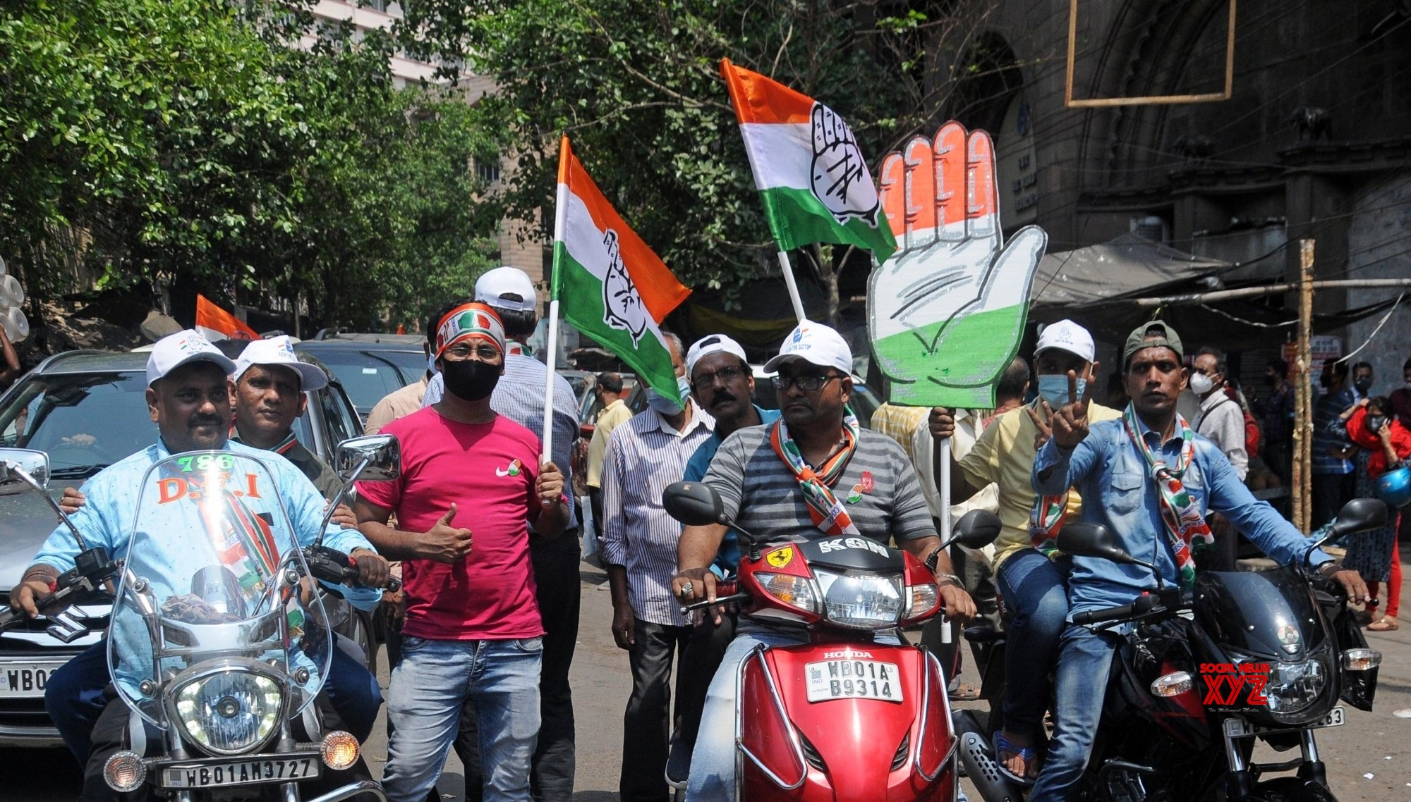 Kolkata: Congress activists took part in a rally without masks and also helmet ahead 4th phase of State Assembly election in Kolkata. #Gallery