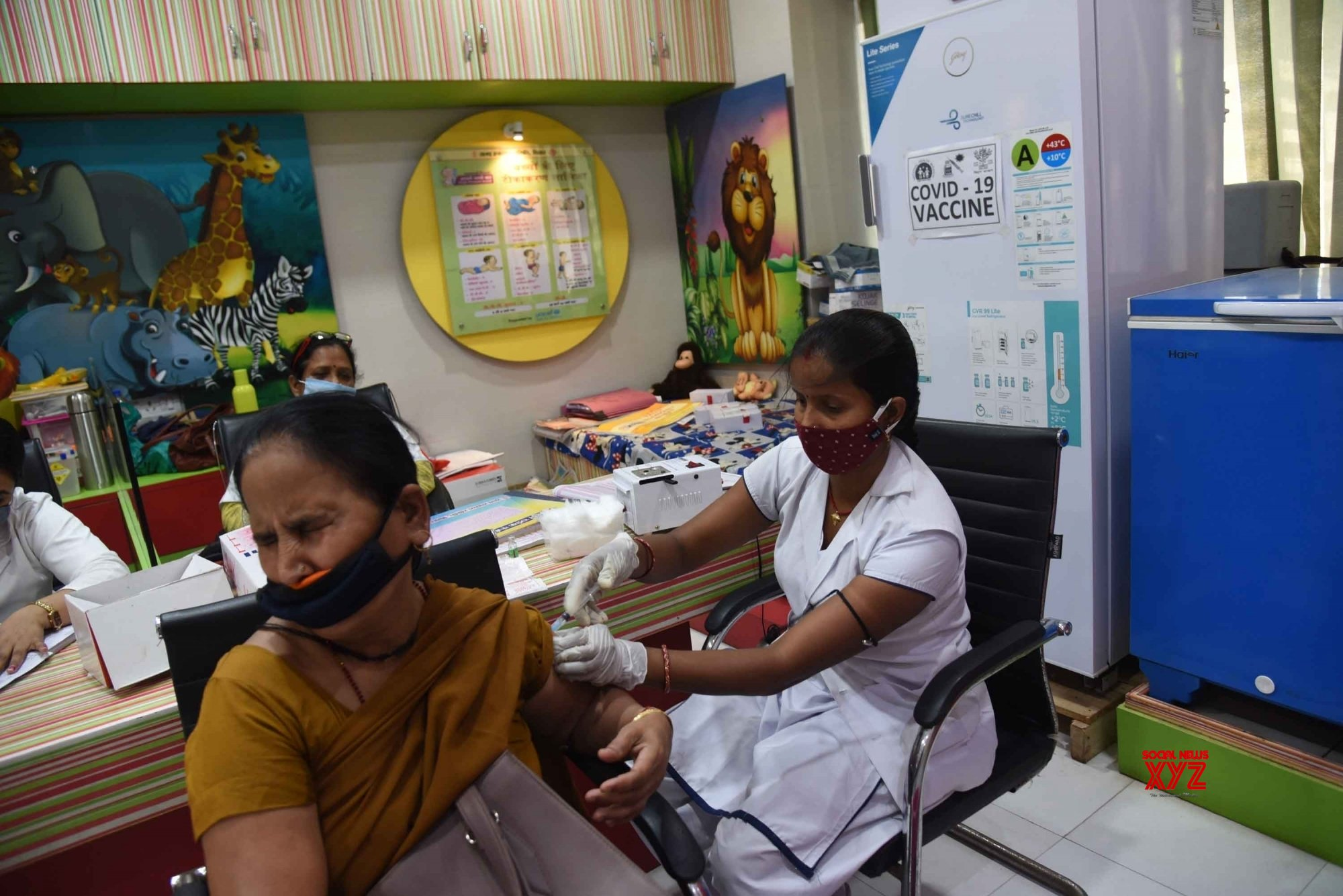 Patna: Beneficiaries receive the first dose of COVID - 19 vaccine during the third phase of the countrywide inoculation drive, in Patna, Thursday, April 8, 2021. #Gallery