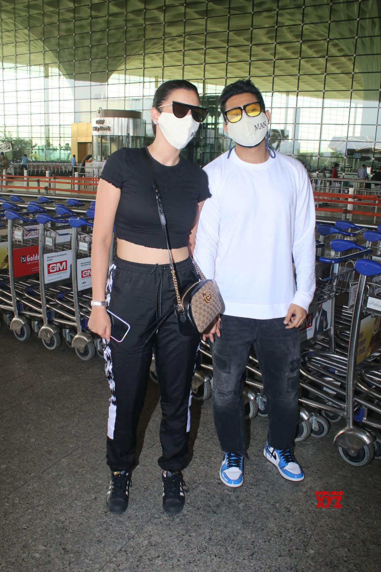 Gauhar Khan &  Zaid Darbar Spotted At Airport Departure - Gallery