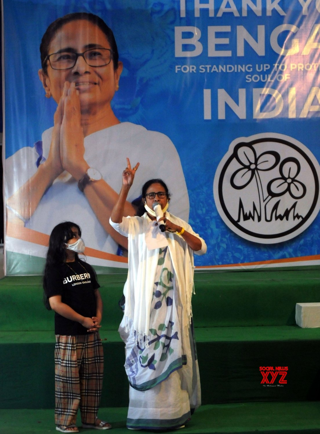 Kolkata : - TMC supremo Mamata Banerjee showing the victroy sign after winning a landslide victory in the West Bengal Assembly Election. #Gallery