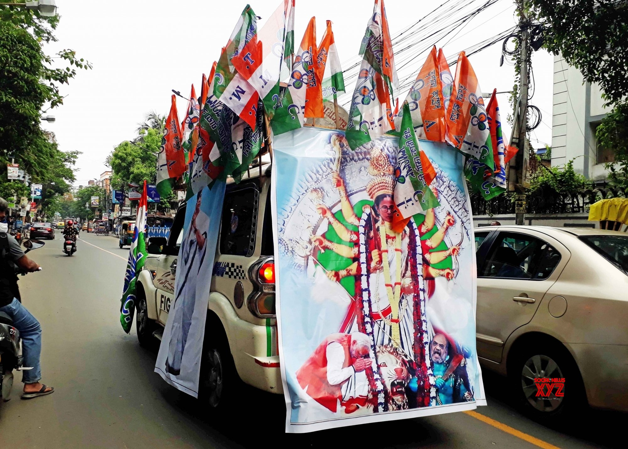 Kolkata : Decorated car with a TMC flag and picture of TMC supremo Mamata Banerjee is rotating over the roads of Kolkata for celebrating their State Assembly election victory in Kolkata on May 4, 2021. #Gallery