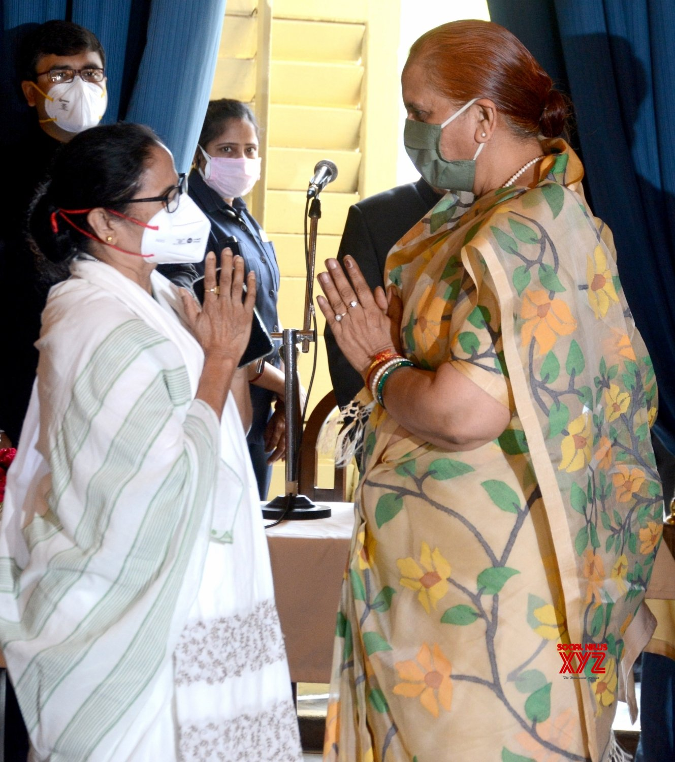 Kolkata: West Bengal Chief Minister Mamata Banerjee and wife of Governor of West Bengal, Sudesh Dhankhar, exchange for greeting each other during Swearing - in - ceremony of new ministers of the State at Raj Bhawan in Kolkata #Gallery