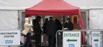 People wait to enter a COVID-19 vaccination center in Blackburn, Britain, on May 21, 2021(Photo by Jon Super/Xinhua/IANS)