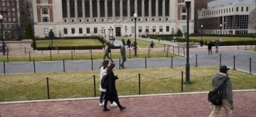 People walk on the campus of Columbia University in New York, the United States, March 10, 2020. (Xinhua/Wang Ying/IANS)