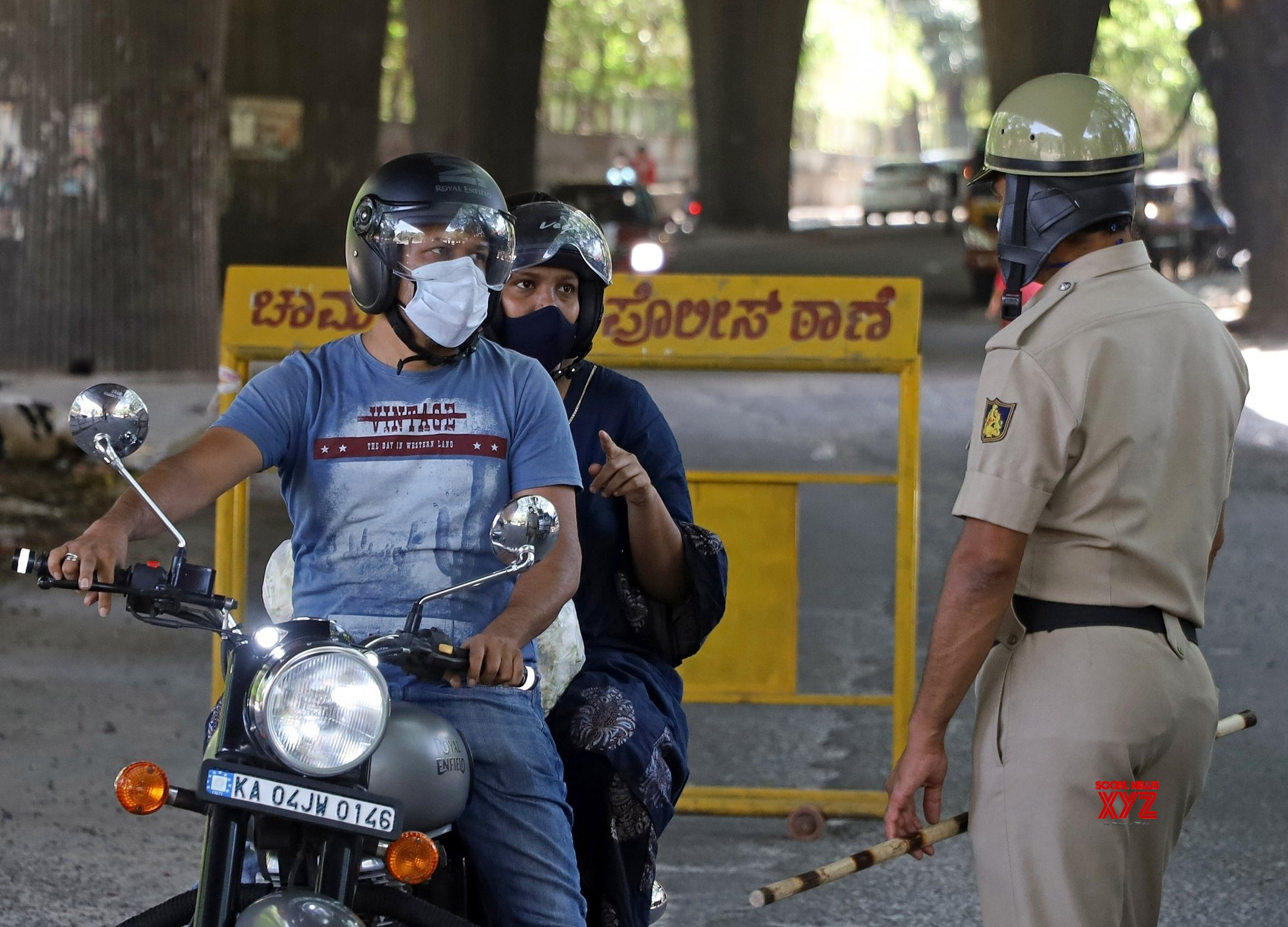 Bengaluru : Police checking the vehicles - at KR Market during lockdown in the wake of the 2nd wave of COVID - 19, in Bengaluru. #Gallery
