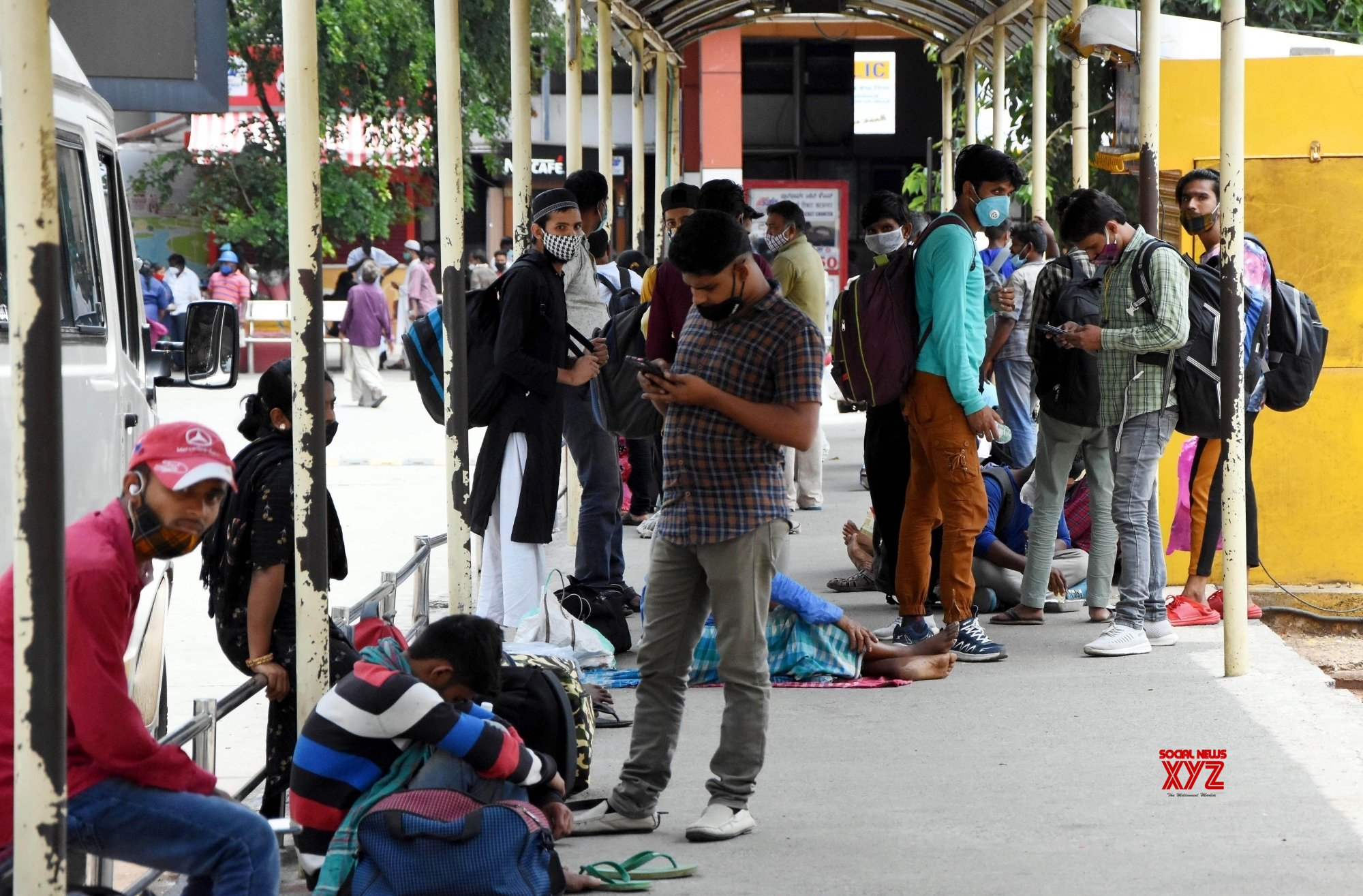 Bengaluru : Migrant workers with their belongings at Bengaluru City Railway station to travel to their native places during Coronavirus lockdown in Bengaluru. #Gallery