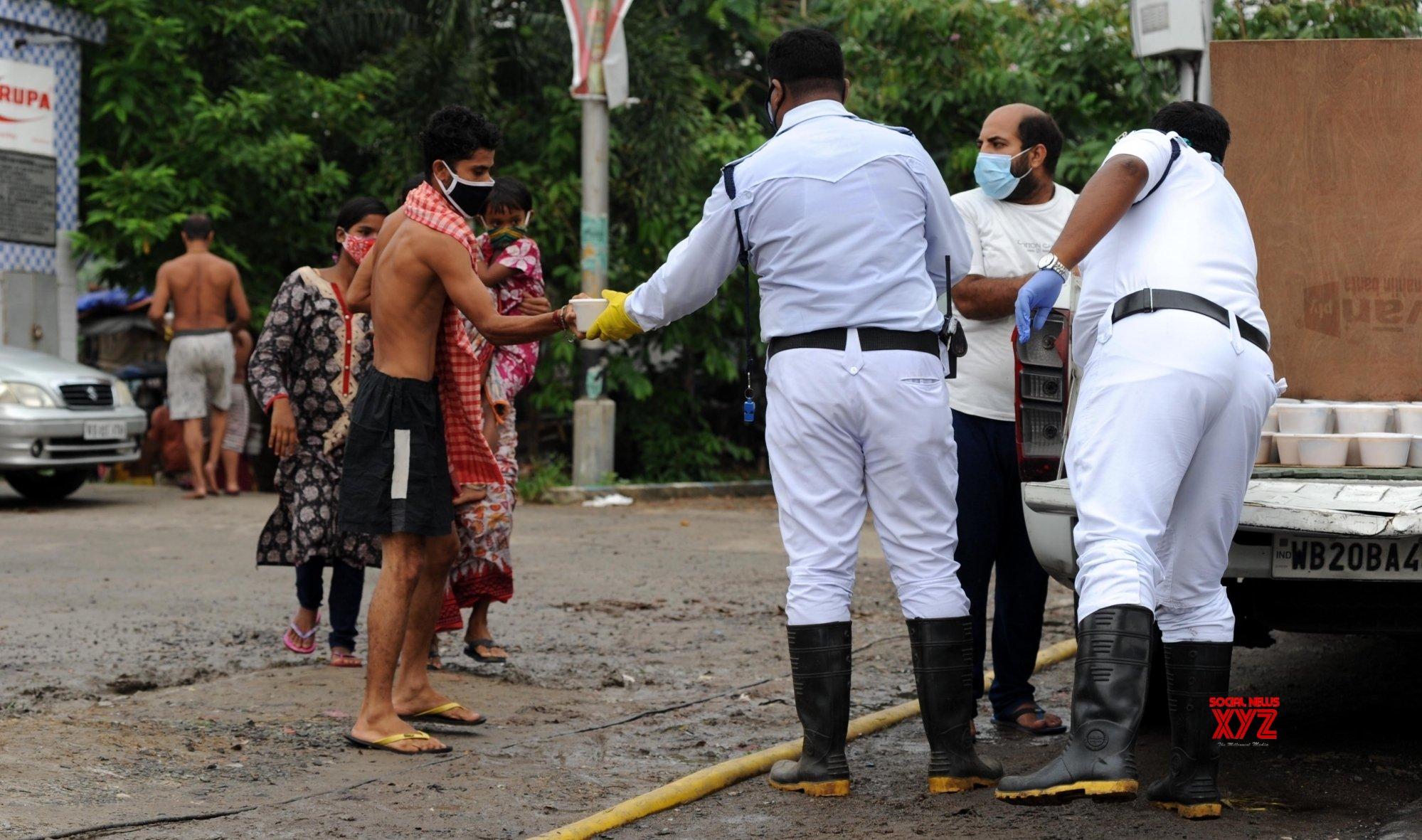 Kolkata: Kolkata police distributed food for needy people and footpath dwellers at Bypass on Mondayduring during the lockdown for COVID 19 Coronavirus pandemic in Kolkata. #Gallery