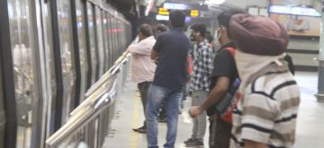 New Delhi :  The Delhi Metro resumed services nearly three weeks in view of the improved Covid situation in the capital but with 50 per cent seating capacity and no provision for standing travel for commuters, in New Delhi on Monday 07 June 2021. (Photo: Wasim Sarvar/ IANS)