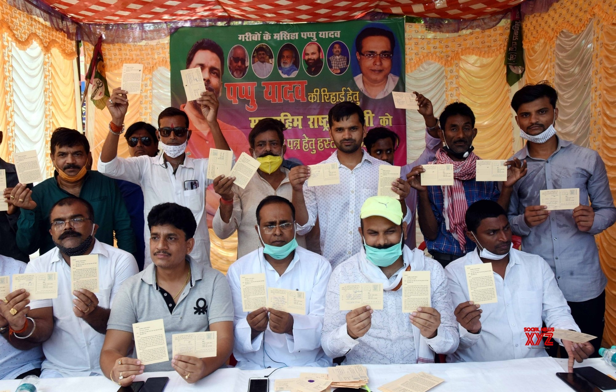 Patna: - Jan Adhikar Party activits shows a Post - Card addressed to President Ram Nath Kovind demanding for the release of party President Pappu Yadav during a signature camp in Patna. #Gallery