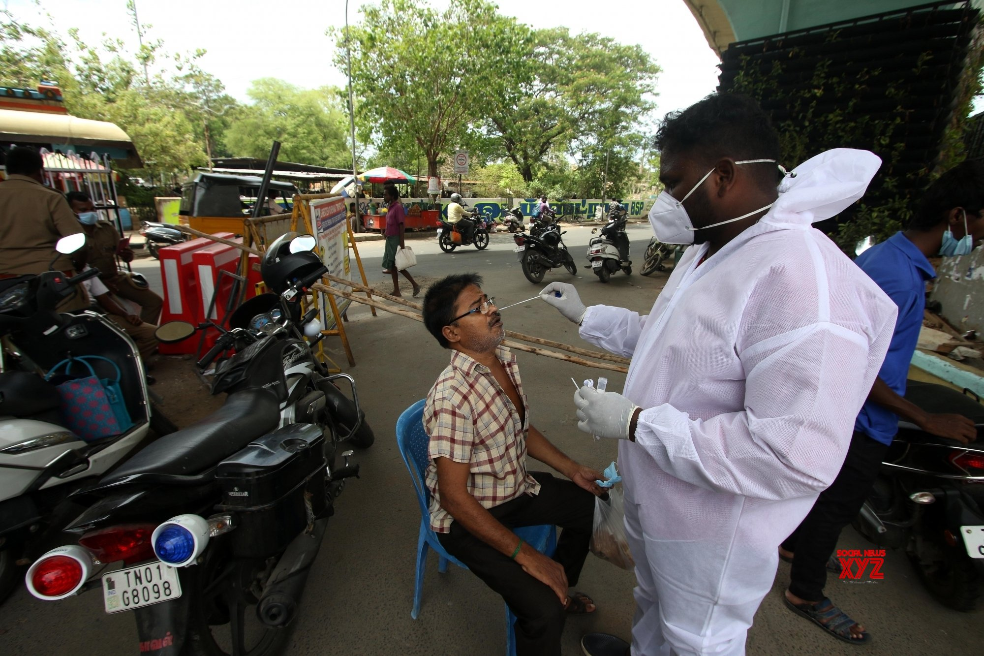 Chennai: Motorists who do not wear masks are being taken to swab test on the middle of the roads - in Chennai. #Gallery