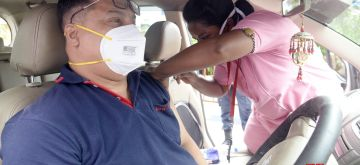 Kolkata:  Medic administers dose of COVID-19 vaccine to a beneficiary during Drive through By Vaccination camp joint initiative by Kolkata Police and AMRI hospital at E.M.Bypass in Kolkata  in Kolkata on Wednesday 09 June, 2021. (Photo: Kuntal Chakrabarty/ IANS)