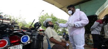Chennai : Motorists who do not wear masks are being taken to swab test on the middle of the roads  in Chennai on Thursday  10 June, 2021. (Photo: R. Parthibhan/IANS)