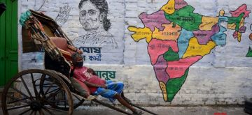 Kolkata: TMC activists making a wall graffiti that has been mapped to India in support of West Bengal Chief Minister Mamata Banerjee as a National leader in Kolkata on Sunday, July 18, 2021. (Photo: Kuntal Chakrabarty/ IANS)