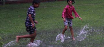 New Delhi: Children enjoying the Rainshower at Congress Headquarters in New Delhi on Tuesday, July 20, 2021. (Photo: Wasim Sarvar/IANS)