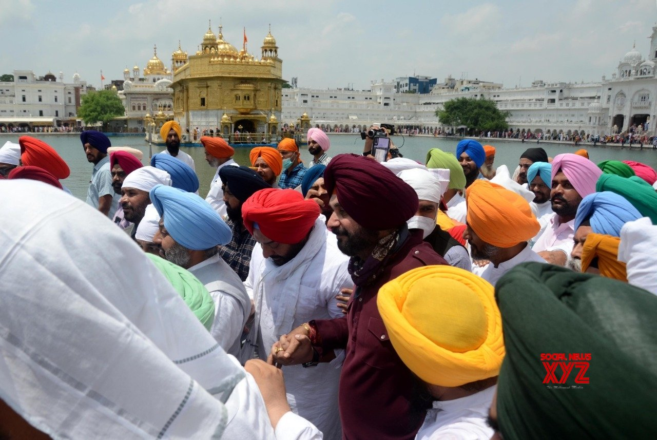 Amritsar: Accompanied by party leaders, newly - appointed Punjab Congress President Navjot Singh Sidhu offers prayers at the Golden Temple in Amritsar #Gallery