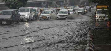 New Delhi : Heavy water logging at Lajpat Nagar road and underpass during heavy rains in New Delhi on Saturday September 11, 2021. (Photo: Wasim Sarvar/IANS)