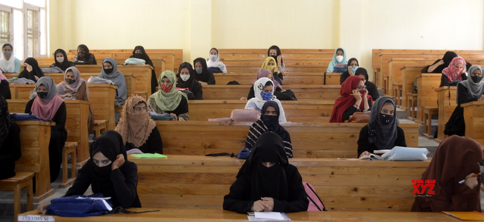 Srinagar: Students from Women's college Baramulla wait for their turn to get covid - 19 vaccine during vaccination drive in Srinagar. #Gallery