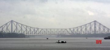 Kolkata: The sky is covered with clouds and rain over the river Ganga in Kolkata on Monday, September 13, 2021. (Photo: Kuntal Chakrabarty/IANS)
