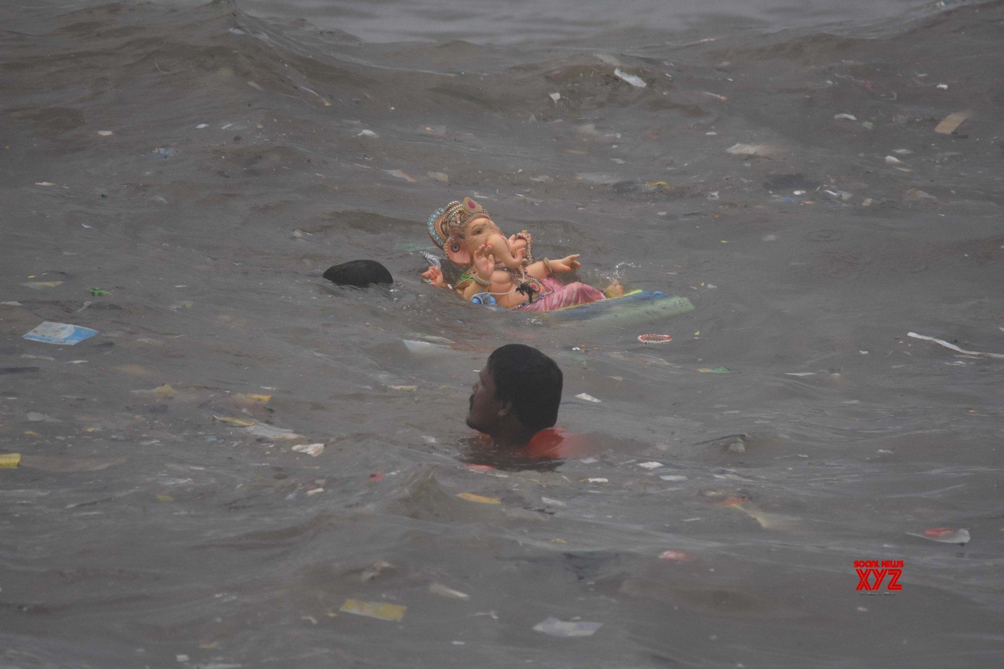 Mumbai: Devotees carrying Gauri and Ganesh idol during immersion at Dadar sea beach in Mumbai. #Gallery