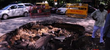 New Delhi: A portion of the road caved in at Copernicus Marg in Delhi on Tuesday, September 14, 2021. (Photo: Qamar Sibtain/ IANS)