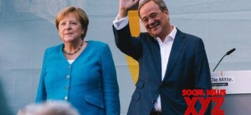 German Chancellor Angela Merkel (L) and Armin Laschet, leader of German Christian Democratic Union (CDU) and chancellor candidate of CDU/Christian Social Union (CSU), attend an election rally of CDU for Germany's federal elections in Aachen, Germany, Sept. 25, 2021. (Photo by Tang Ying/Xinhua/IANS)