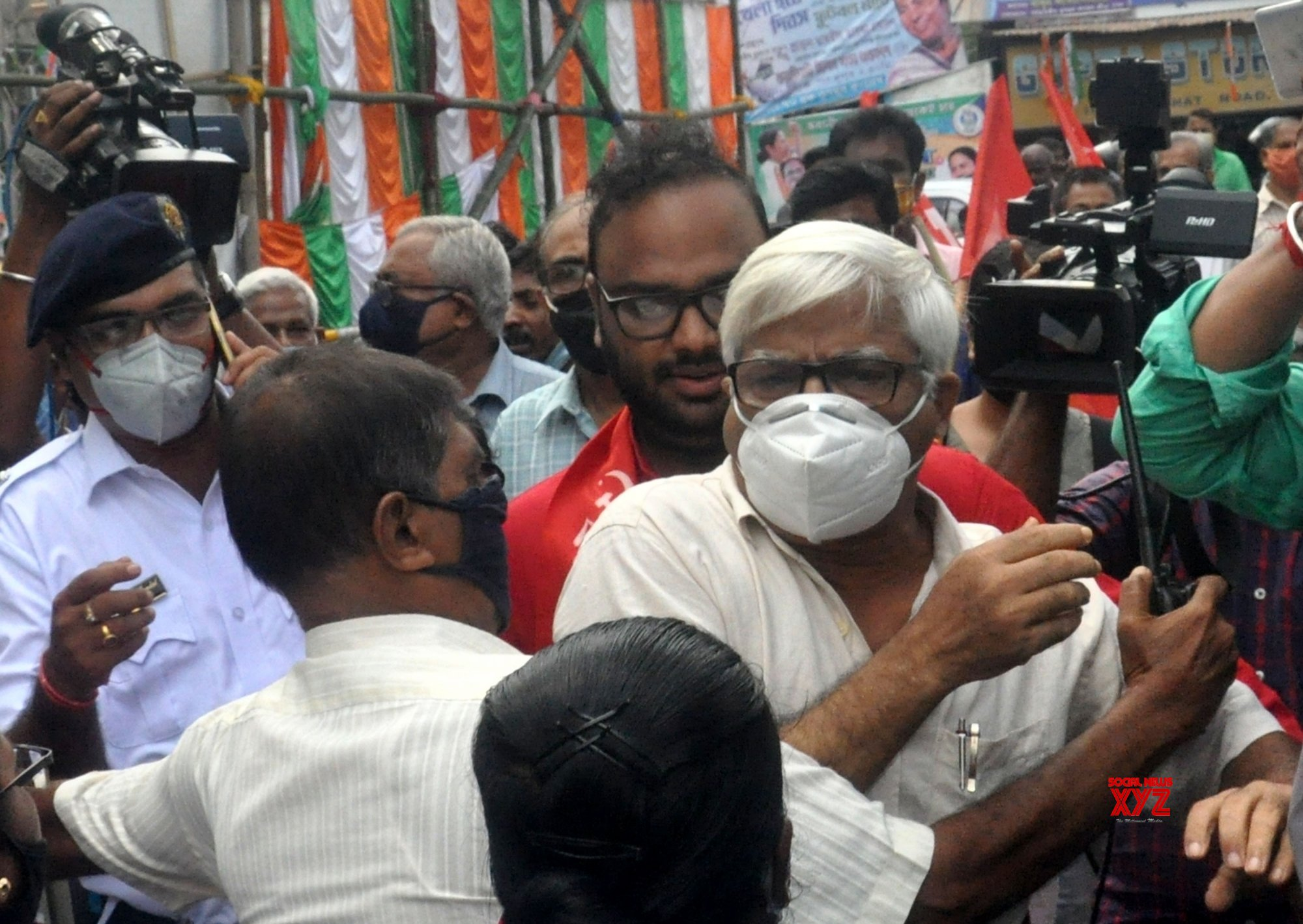 Kolkata : Police personnel obstructing CPIM Candidate for up coming By Election at Bhawanipur Assembly seat Sreejib Biswas and party leader Sujan Chakraborty during a campaign. #Gallery